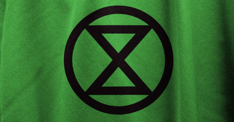 extinction rebellion flag Image by Pete Linforth from Pixabay